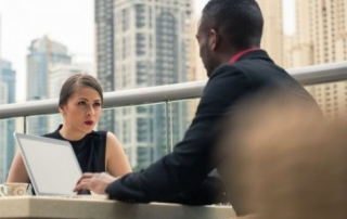 man and woman in feedback conversation
